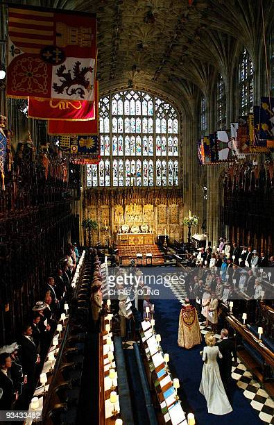Britain's Prince Charles and Camilla the Duchess of Cornwall walk up the aisle during their wedding blessing at Windsor Castle's St George's Chapel...