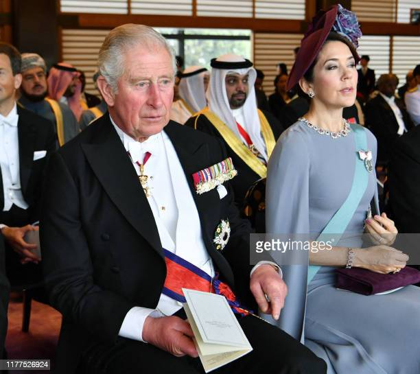 Britain's Prince Charles and Crown Princess Mary of Denmark attend the enthronement ceremony where Emperor Naruhito officially proclaims his...