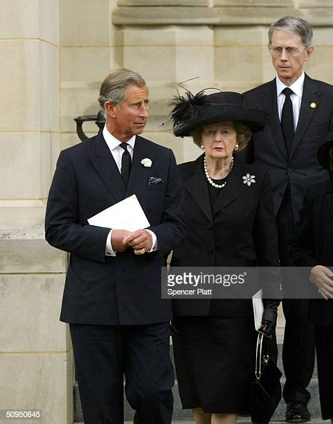Britain's Prince Charles and former British Prime Minister Margaret Thatcher exit former President Ronald Reagan's State Funeral at the National...