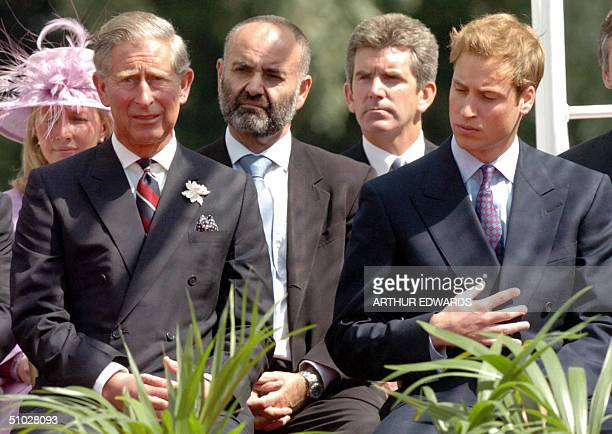 Britain's Prince Charles and his son Prince William attend the unveiling ceremony for the Princess Diana memorial fountain in London's Hyde Park 06...