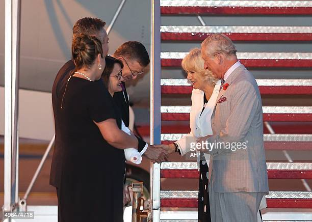 Britain's Prince Charles and his wife Camilla arrive in Sydney on November 10 2015 as they are welcomed by Michael Miller Official Secretary to the...