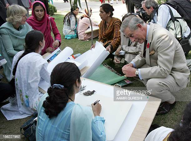 Britain's Prince Charles and his wife Camilla Duchess of Cornwall chat with students of Fatima Jinnah University during their visit in Rawalpindi 31...