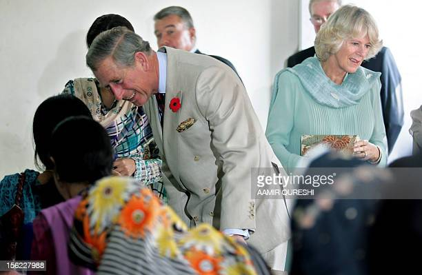 Britain's Prince Charles and his wife Camilla Duchess of Cornwall speak with students of Fatima Jinnah University in Rawalpindi 31 October 2006...