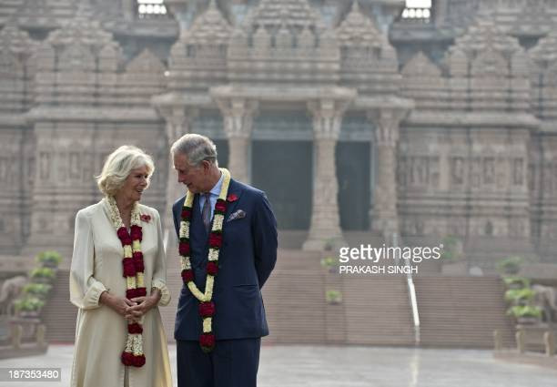 Britain's Prince Charles and his wife Camilla Duchess of Cornwall pose during a visit to Akshardham temple in New Delhi on November 8 2013 Britain's...