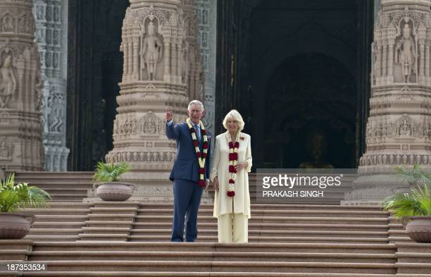 Britain's Prince Charles and his wife Camilla Duchess of Cornwall visit the Akshardham temple in New Delhi on November 8 2013 Britain's Prince...