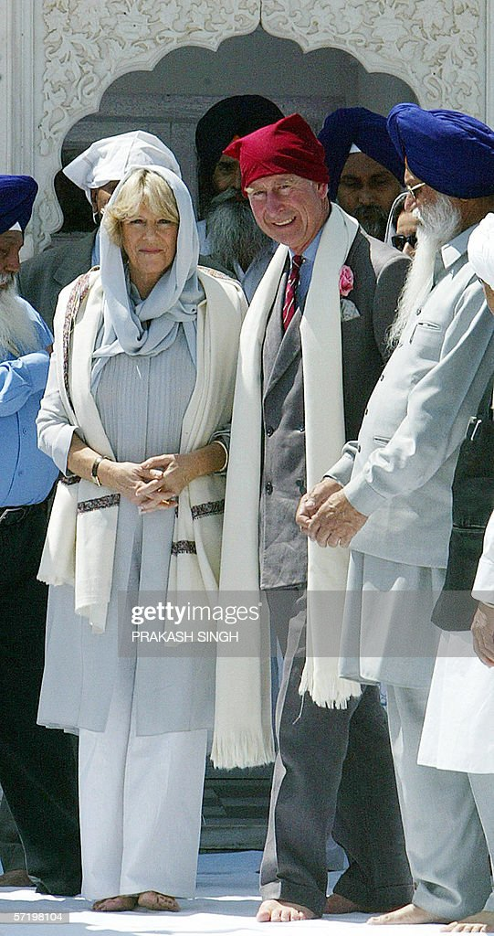 Britain`s Prince Charles and his wife Camilla Duchess of York leave the Anadpur Saheb Gurudwara after offering prayers in the town of Anadpur Saheb...