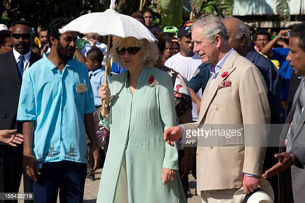 Britain's Prince Charles and his wife Camilla visit locals at Boera Village some 20kms west of Port Moresby on November 4 2012 Papua New Guinea is...