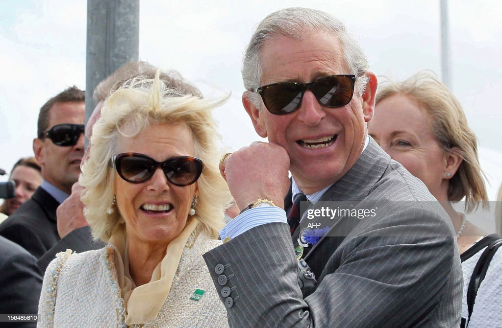 Britain's Prince Charles (2nd L) and his wife Camilla (C) visit the Canterbury A and P show in Christchurch on November 16, 2012. Britain's Prince Charles and his wife Camilla are on the last leg of a tour to mark Queen Elizabeth II's diamond jubilee which has also included Papua New Guinea and Australia and ends on November 16. AFP PHOTO / POOL / Kirk Hargreaves / AFP PHOTO / POOL / Kirk Hargreaves