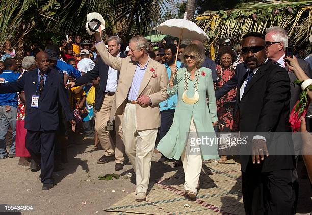 Britain's Prince Charles and his wife Camilla wave to the locals at Boera Village some 20kms west of Port Moresby on November 4 2012 Papua New Guinea...