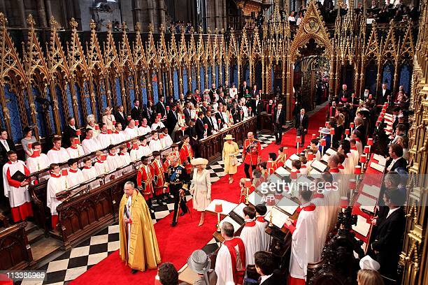 Britain's Prince Charles and The Duchess of Cornwall followed by Queen Elizabeth II and The Duke of Edinburgh arrive at Westminster Abbey in London...