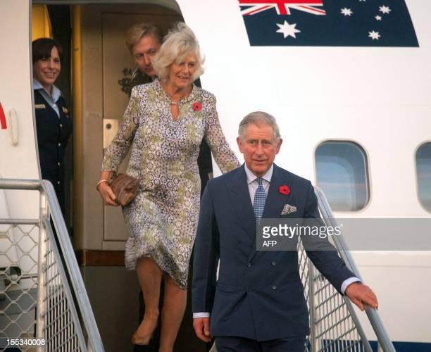 Britain's Prince Charles and wife Camilla arrive at Port Moresby's Jackson's International Airport on November 3 as several thousand wellwishers...