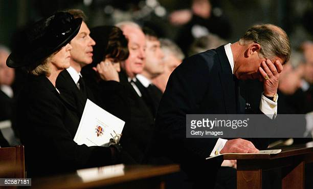 Britain's Prince Charles bows his head as he sits with Camilla Parker-Bowles , Britain's Prime Minister Tony Blair and his wife Cherie at a service...