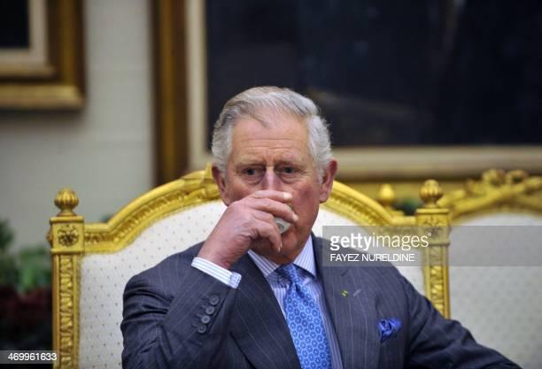 Britain's Prince Charles drinks coffee during a meeting with Saudi National Guard Minister Mutaib bin Abdullah bin Abdulaziz on February 17 2014 in...