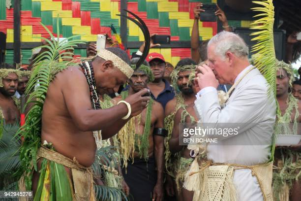 Britain's Prince Charles drinks kava with Chief Seni Mao Tirsupe the President of the Malvatumauri Council of Chiefs to the Chiefs Nakamal in Port...