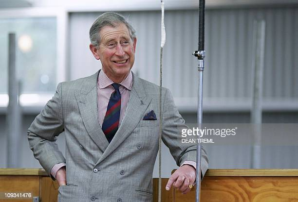 Britain's Prince Charles enjoys a laugh as he watches world champion blade shearer Peter Casserley shear a Merino sheep with a pair of hand shears...