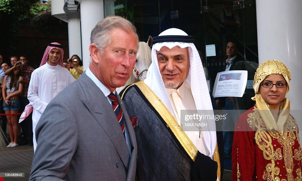 Britain's Prince Charles (L) flanked by Prince Turki Al Faisal Bin Abdulaziz Al Saud of Saudi Arabia, arrives to attend The Royal Premiere of Arabia 3D in London's South Bank, on May 24, 2010.