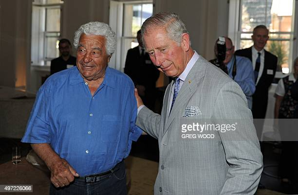 Britain's Prince Charles greets renowned local chef Antonio Carluccio as he tours the restored historical State Buildings in Perth on November 15...