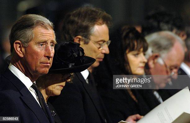 Britain's Prince Charles , his fiance Camilla Parker Bowles , British Prime Minister Tony Blair and his wife Cherie stand during a memorial Mass for...