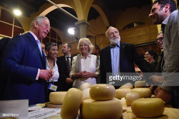 Britain's Prince Charles his wife Camilla the Duchess of Cornwall and founder and president of the gastronomic movement Slow Food Carlo Petrini meet...