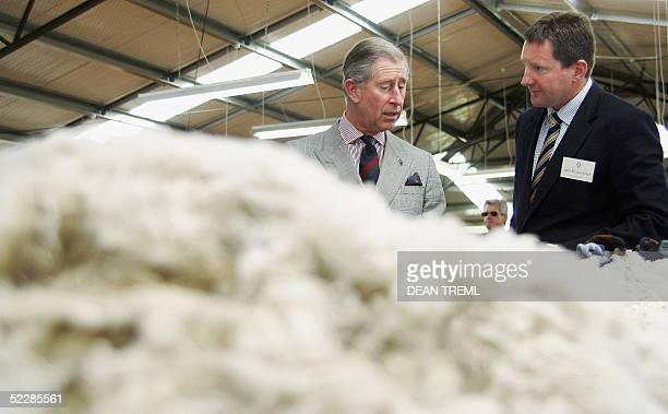 Britain's Prince Charles inspects a table of Merino fleece with John Brakenridge CEO of the New Zealand Merino Company during a visit to Moutere...