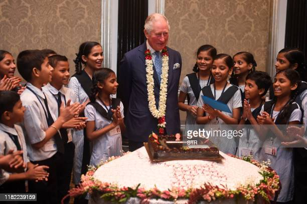 Britain's Prince Charles interacts with children from the Kaivalya Education Foundation supported by the British Asian trust in Mumbai on November 14...
