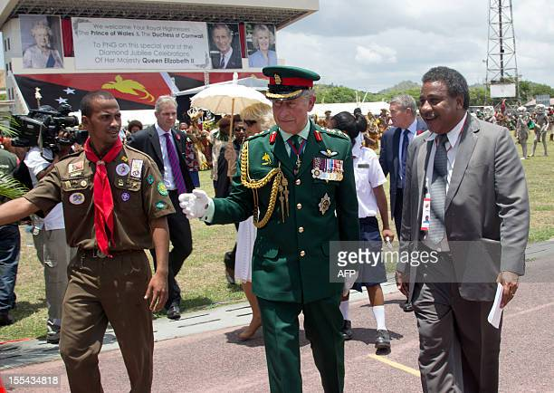 Britain's Prince Charles is escorted through the crowds at Sir John Guise stadium in Port Moresby on November 4 2012 during a visit with his wife...