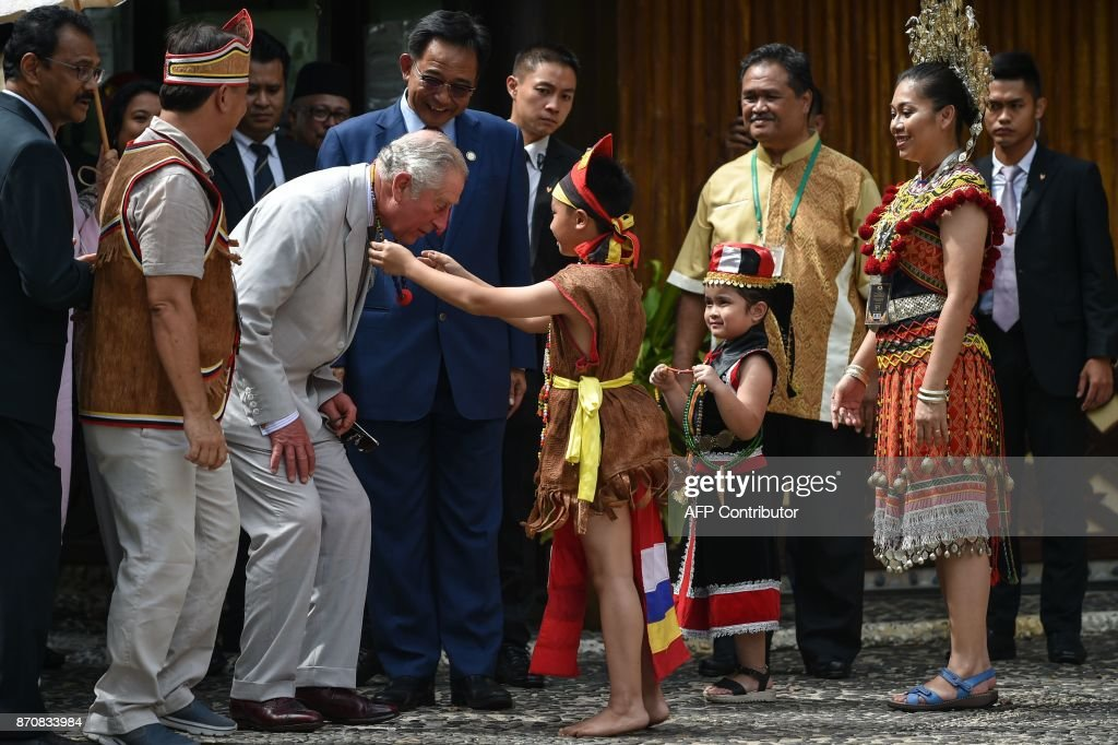 Britain S Prince Charles Is Greeted By A Boy In Bidayuh Traditional News Photo Getty Images