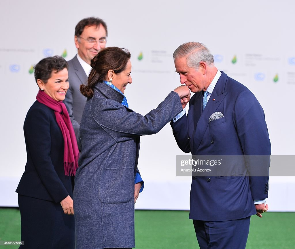 Britain's Prince Charles (R) is greeted by French Minister of Ecology, Sustainable Development and Energy, Segolene Royal (R-2) as he arrives for the COP21, United Nations Conference on Climate Change, in Le Bourget, north of Paris, France, on November 30, 2015.