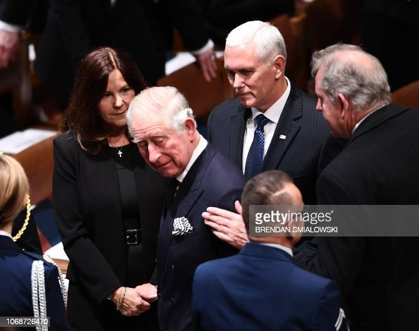 Britain's Prince Charles is greeted by Karen Pence and her husband US Vice President Mike Pence as they arrive for the funeral service for former US...