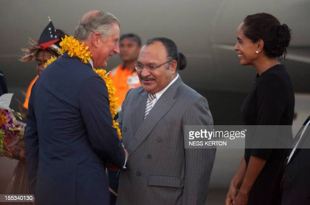 Britain's Prince Charles is greeted by Papua New Guinea's Prime Minister Peter ONeill and his wife Lynda May Babao after arriving at Port Moresby's...