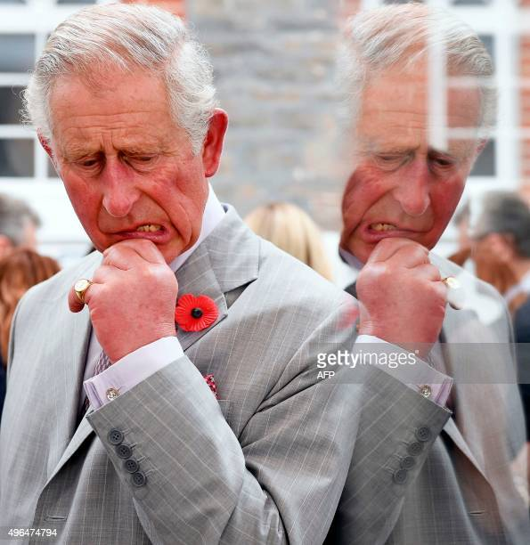 Britain's Prince Charles is seen reflected in a door as he visits the Seppeltsfield Winery in the Barossa Valley of South Australia, some 70...