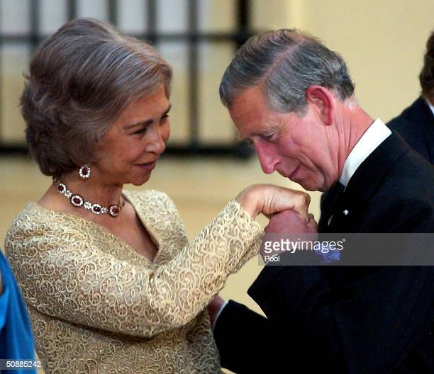 Britain's Prince Charles kisses the hand of Queen Sofia of Spain as he arrives to attend a gala dinner at El Pardo Royal Palace May 21 2004 in Madrid...