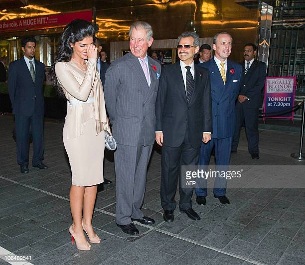 Britain�s Prince Charles laughs with Princess Amira wife of hotel owner Prince Alwaleed Bin Talal before a tour during the official reopening of the...