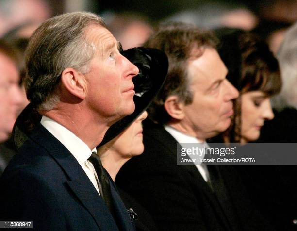 Britain's Prince Charles looks up as he sits with Camilla Parker-Bowles , Britain's Prime Minister Tony Blair and his wife Cherie Blair at a service...