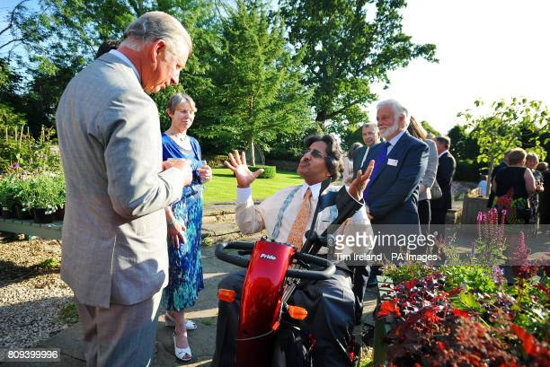 Britain's Prince Charles meets His Excellency Sheikh Hamad bin Ali Al-Thani from the Qatar royal family at the Garden Organic charity reception at...