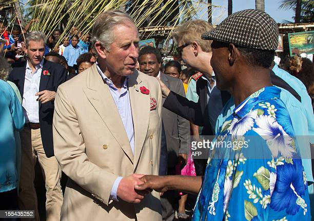 Britain's Prince Charles meets locals at Boera Village some 20kms west of Port Moresby on November 4 2012 Papua New Guinea is the first stop on...