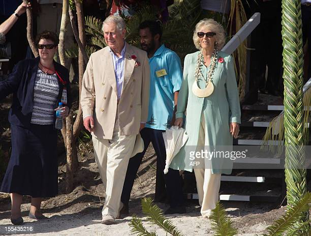 Britain's Prince Charles @nd L and his wife Camilla arrive at Boera Village some 20kms west of Port Moresby on November 4 2012 Papua New Guinea is...