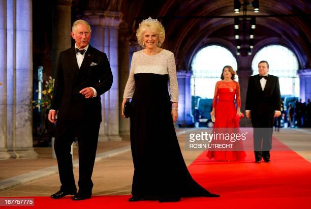 Britain's Prince Charles of Wales and his wife Camilla, Duchess of Cornwall arrive on April 29, 2013 to attend a dinner at the National Museum in...