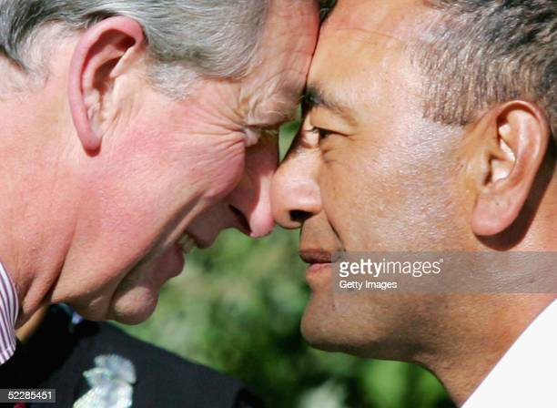 Britain's Prince Charles performs a traditional Maori hongi a greeting where two people press noses with Lieutenant Donald Ripia of the Royal New...