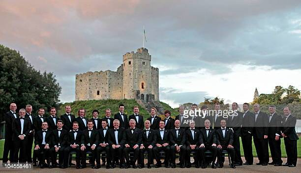 """Britain's Prince Charles , poses for a group photograph with the Europe and America Ryder Cup teams, before the """"Welcome to Wales 2010 Ryder Cup""""..."""