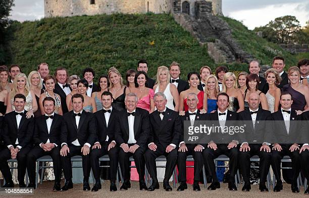 Britain's Prince Charles , poses for a group photograph with the Europe and America Ryder Cup teams, and their wives and girlfriends, before the...