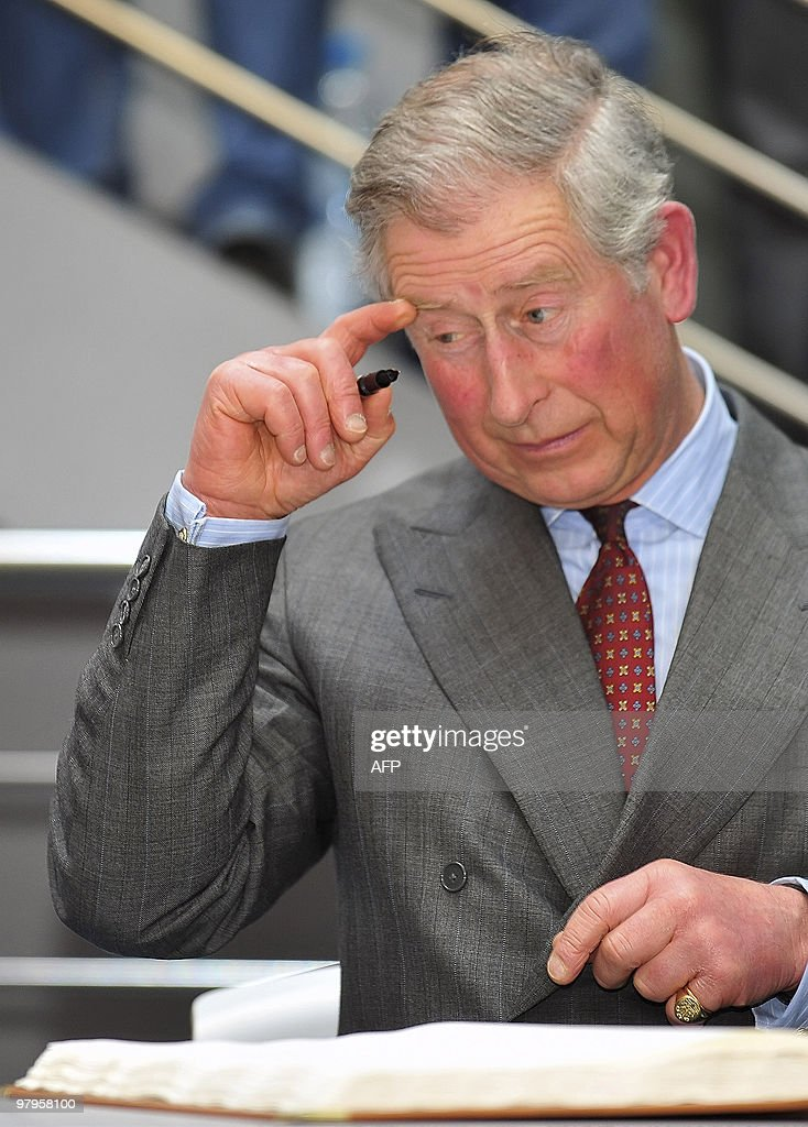 Britain's Prince Charles prepares to sig : News Photo
