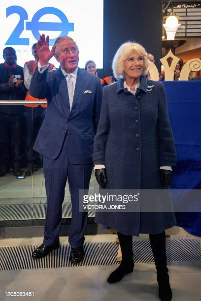 Britain's Prince Charles, Prince of Wales and Britain's Camilla, Duchess of Cornwall react during a visit to the London Transport Museum in London on...