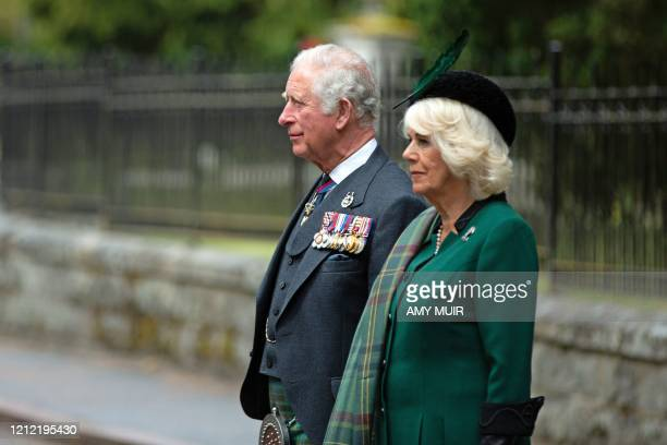 Britain's Prince Charles, Prince of Wales and Britain's Camilla, Duchess of Cornwall observe a 2 minute silence to mark the 75th anniversary of VE...