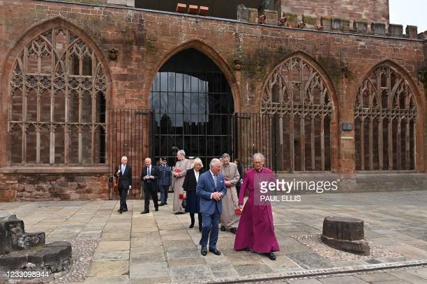 Britain's Prince Charles, Prince of Wales and Britain's Camilla, Duchess of Cornwall are accompanied by the Bishop of Coventry, Rev Christopher...