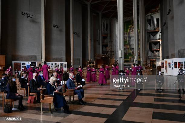 Britain's Prince Charles, Prince of Wales and Britain's Camilla, Duchess of Cornwall attend a service during their visit to Coventry Cathedral in...