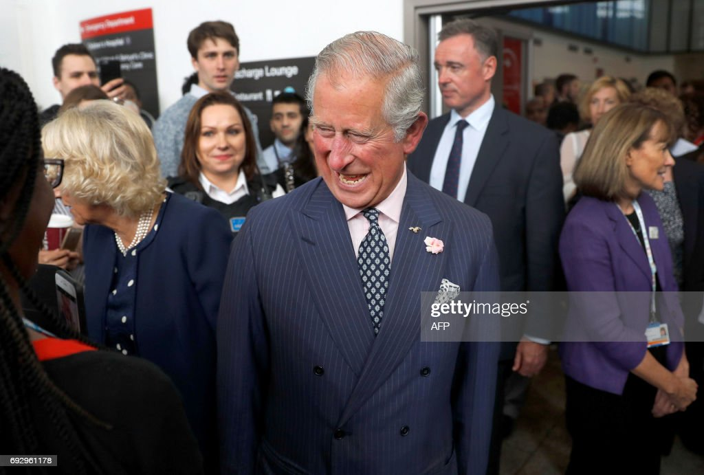 Britain's Prince Charles, Prince of Wales and Britain's Camilla, Duchess of Cornwall talk to staff during a visit to the Royal London Hospital, in London on June 6, 2017. /