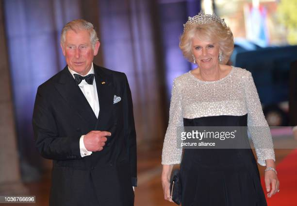 Britain's Prince Charles, Prince of Wales and Britain's Duchess of Cornwall, Camilla arrive for a dinner at the occasion of the abdication of Dutch...