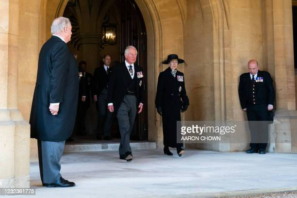 Britain's Prince Charles, Prince of Wales and Britain's Princess Anne, Princess Royal, prepare to follow the ceremonial funeral procession of...