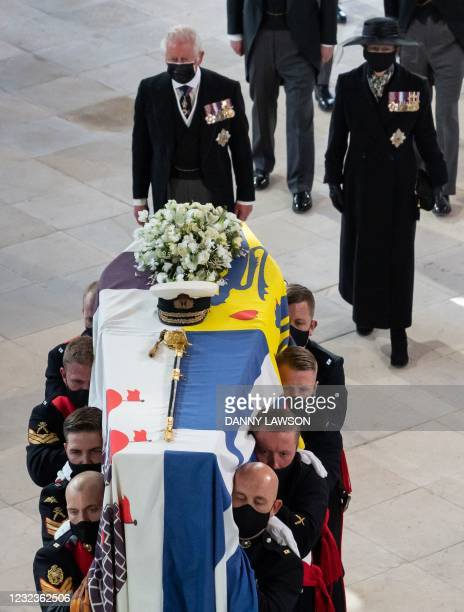 Britain's Prince Charles, Prince of Wales and Britain's Princess Anne, Princess Royal, follow the coffin as it arrives into St George's Chapel for...